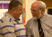 Colin Kelly recieving his CPAGB award from the President of the PAGB.